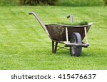 Old Wheelbarrow On A Lawn With...