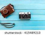 the old camera lies on a wooden ... | Shutterstock . vector #415489213