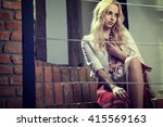 the blond sexy girl dressed in... | Shutterstock . vector #415569163