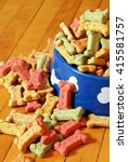 Small photo of An over abundant supply of various dog treats flowing from a dish.