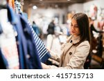 beautiful businesswoman buying... | Shutterstock . vector #415715713