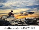 sad boy on the rock and sky... | Shutterstock . vector #415793173