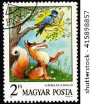 Small photo of SINGAPORE â?? MAY 5, 2016: A stamp printed in Hungary from the Fairy Tales issue shows The Fox and the Raven (Aesop), circa 1987.