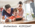 a modern family using a laptop... | Shutterstock . vector #415922647