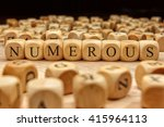 numerous word written on wood... | Shutterstock . vector #415964113