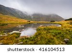 Small Tarn With Rocks In Foggy...