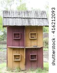 Small photo of KOLBUSZOWA, POLAND, MAY 3, 2016 : Old multiposition beehive in open-air museum. Ethnographic Park in Kolbuszowa is museum located on an area of 30 hectares, there are more than 80 objects