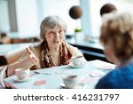 senior woman playing cards with ... | Shutterstock . vector #416231797
