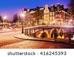 Stock photo traditional dutch old houses and bridges on the canals in amsterdam at night the netherlands 416245393
