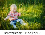 child sitting on the grass   Shutterstock . vector #416642713