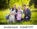 a happy family sit in the grass ... | Shutterstock . vector #416687197