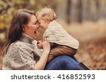 beloved mother plays and... | Shutterstock . vector #416852593