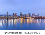 Tranquil Water Cityscape And...