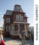Small photo of New York City - April 23, 2016: Cornelia Parker's Transitional Object (Psycho Barn) atop the roof of the Metropolitan Museum of Art in New York. Inspired by Alfred Hitchcock's 1960 film Psycho.
