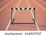 Jump Hurdle On Running Track