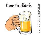hand holding a full glass of...   Shutterstock .eps vector #417034747