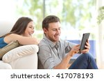 cheerful couple using a tablet... | Shutterstock . vector #417078193
