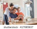 a modern family using a digital ... | Shutterstock . vector #417085837