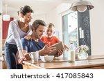 a modern family using a digital ... | Shutterstock . vector #417085843