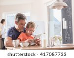 a father and son using a tablet ... | Shutterstock . vector #417087733
