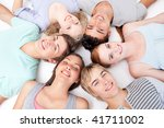 teens relaxing on floor with... | Shutterstock . vector #41711002