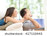 Playful Couple Covering Eyes A...
