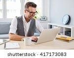 young happy designer working on ... | Shutterstock . vector #417173083