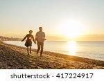happy loving couple walking on... | Shutterstock . vector #417224917