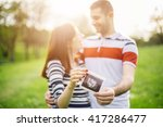 happy couple are holding...   Shutterstock . vector #417286477