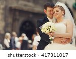 hugs and smiles   groom stands... | Shutterstock . vector #417311017