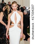 Small photo of May 2, 2016 - New York, New York - Karlie Kloss attends the Metropolitan Museum of Art Costume Institute Gala, Manus x Machina: Fashion in an Age of Technology