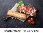 ciabatta sandwich with romaine... | Shutterstock . vector #417379123