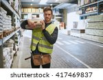 young handyman selecting a... | Shutterstock . vector #417469837