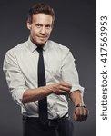 handsome businessman rolling up ... | Shutterstock . vector #417563953