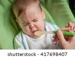 beautiful baby refuses to eat | Shutterstock . vector #417698407