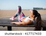 fitness woman doing crunches... | Shutterstock . vector #417717433