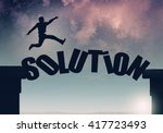 Small photo of Businessman jumping over gap