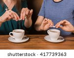 hands of two women putting... | Shutterstock . vector #417739363