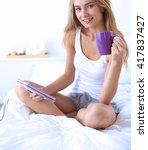beautiful woman drinking a... | Shutterstock . vector #417837427