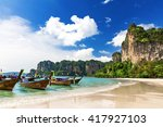 long boats and railay beach in... | Shutterstock . vector #417927103