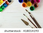 Small photo of Art of Painting. Painting set: brushes, paints, crayons, watercolor, acrylic paint on a white wooden background