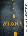 Small photo of Start word on New asphalt texture with white dashed line