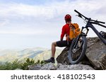 mountain biker looking at view... | Shutterstock . vector #418102543