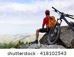 mountain biker looking at view... | Shutterstock . vector #418102543