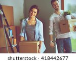 happy young couple unpacking or ... | Shutterstock . vector #418442677