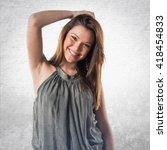 pretty girl posing in studio | Shutterstock . vector #418454833