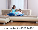 family playing video game on... | Shutterstock . vector #418516153