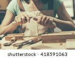 woman carpentry at home  wooden ... | Shutterstock . vector #418591063