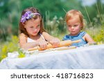 Two Little Girls Working...