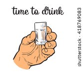 hand holding a full glass of...   Shutterstock .eps vector #418769083